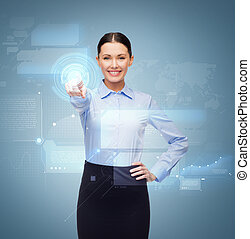 smiling businesswoman pointing finger to button - business ...