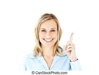 Smiling businesswoman pointing upwards with her finger...