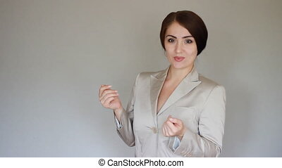 Smiling businesswoman presenting product. Young woman talking, shows hands to the product.