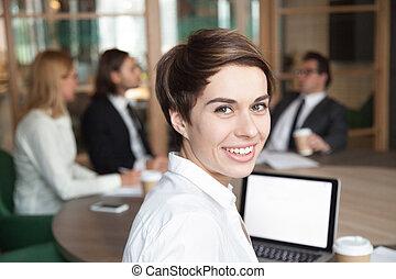 Smiling businesswoman professional interpreter looking at camera