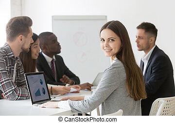 Smiling businesswoman professional or intern looking at camera a