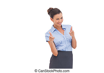 Smiling businesswoman showing something with fingers