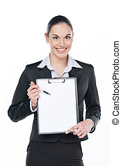 Smiling businesswoman showing with a pan something on blank tablets. Standing isolated on white