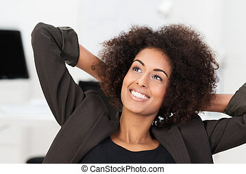 Smiling businesswoman smiling as she relaxes