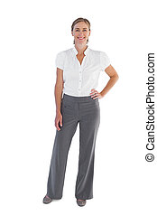 Smiling businesswoman standing with her hand on her hip