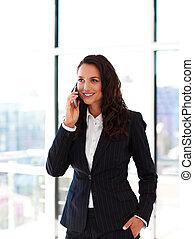 Smiling businesswoman talking on phone