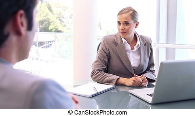 Smiling businesswoman talking with an man