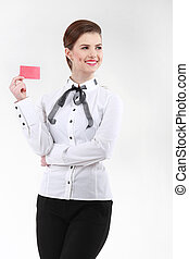 Smiling businesswoman with a blank business badge isolated on white