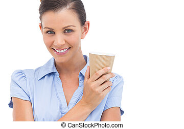 Smiling businesswoman with arms crossed and coffee cup