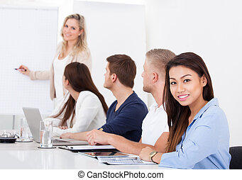 Smiling Businesswoman With Colleagues