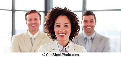 Smiling businesswoman with folded arms in office