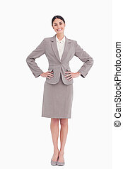 Smiling businesswoman with hands on her hip