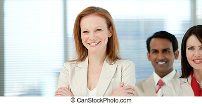 Smiling businesswoman with her colleagues