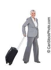 Smiling businesswoman with her luggage