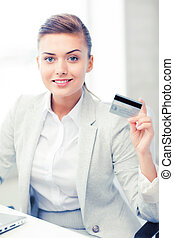 businesswoman with laptop showing credit card