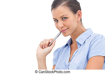 Smiling businesswoman with pen