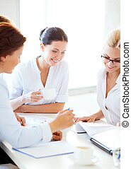 businesswoman with team on meeting in office