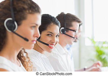 Smiling businesswoman working in call center