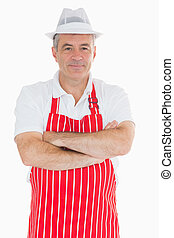 Smiling butcher with crossed arms