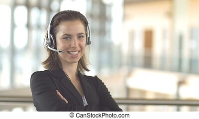 Smiling call centre customer service support operator receptionist woman headset