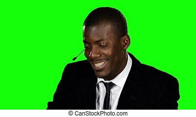 Smiling call centre worker. Green screen