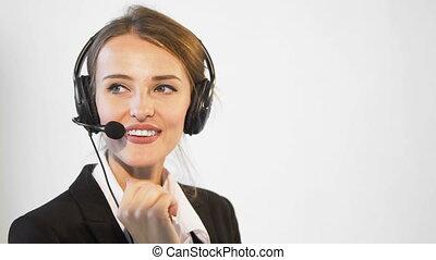 Smiling Callcenter Operator - Smiling young dark hair...