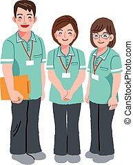 Smiling caregiver staffs - Three professional caregivers are...