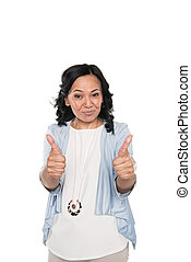 smiling casual asian woman showing thumbs up isolated on white