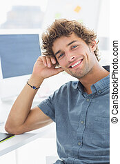 Smiling casual young man in office - Portrait of a handsome...