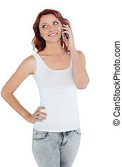 Smiling casual young woman using mobile phone