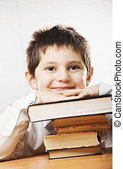 Smiling caucasian boy in classroom