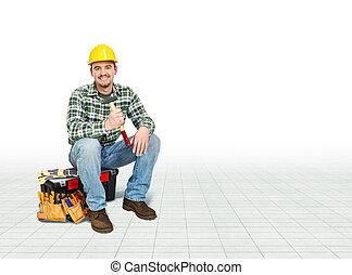 handyman - smiling caucasian handyman sit on toolbox