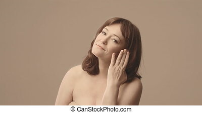 Smiling Caucasian middle age woman. Brown- haired. Natural.  . High quality 4k footage