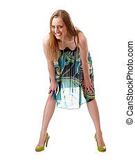 smiling caucasian woman bending forward in dress