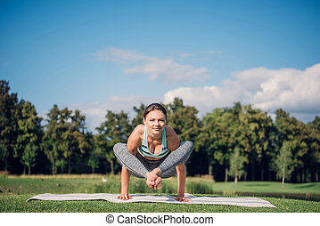 caucasian woman performing yoga