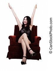 Smiling Caucasian Woman Sitting In Chairs With Arms Up