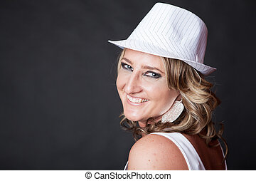 Smiling Caucasian woman wearing a pinstrip white hat