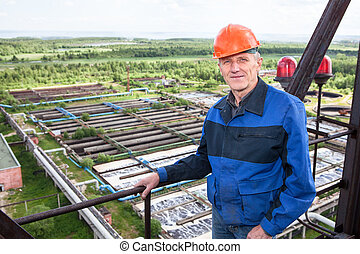 Smiling Caucasian worker standing for high altitude platform...