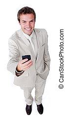 Smiling charismatic businessman sending a text