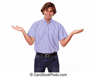 Smiling charismatic man in jeans holds palms out,