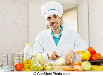 Smiling  chef does vegetarian lunch