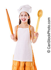Smiling chef girl with ladle and rolling pin, isolated on...