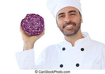 Smiling chef holding a red cabbage