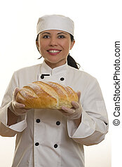 Smiling Chef holding baked bread loaf