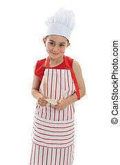 Smiling chef holding kitchen utensils
