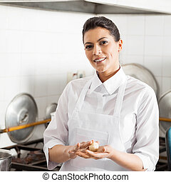 Smiling Chef Holding Pasta Dough Ball In Kitchen
