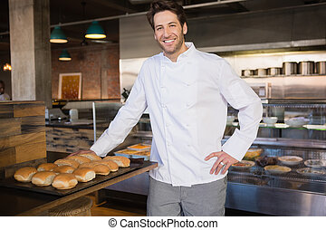 Smiling chef leaning on counter
