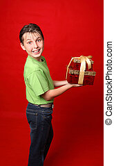 Smiling child carrying gifts