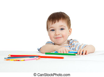 smiling child drawing with color pencils