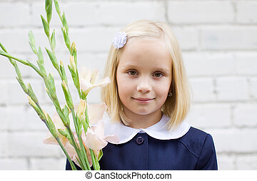 Smiling child girl with flowers